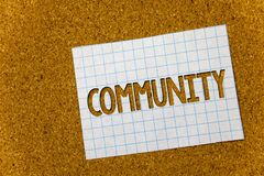 Text sign showing Community. Conceptual photo Neighborhood Association State Affiliation Alliance Unity Group Cork background note. Book paper ideas messages Stock Photo