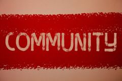 Text sign showing Community. Conceptual photo Neighborhood Association State Affiliation Alliance Unity Group Ideas messages red p. Aint painting light brown royalty free stock photography