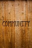 Text sign showing Community. Conceptual photo Neighborhood Association State Affiliation Alliance Unity Group Ideas messages woode. N background intentions Royalty Free Stock Images