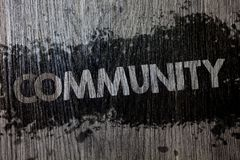Text sign showing Community. Conceptual photo Neighborhood Association State Affiliation Alliance Unity Group Wooden wood backgrou. Nd black splatter paint ideas Stock Photography