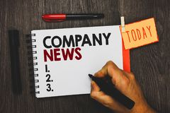 Text sign showing Company News. Conceptual photo Latest Information and happening on a business Corporate Report Man holding marke. R notebook clothespin hold stock photos