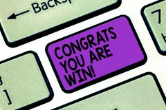 Text sign showing Congrats You Are Win. Conceptual photo Congratulations for your accomplish competition winner Keyboard. Key Intention to create computer royalty free stock photos