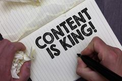 Free Text Sign Showing Content Is King. Conceptual Photo Words What Sells Products And Provide Good Marketing Man Holding Marker Notebo Stock Photos - 125705503
