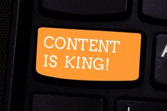 Text sign showing Content Is King. Conceptual photo Content is the heart of todays marketing strategies Keyboard key. Intention to create computer message stock photography