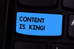 Text sign showing Content Is King. Conceptual photo Content is the heart of todays marketing strategies Keyboard key. Intention to create computer message stock photo