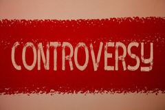 Text sign showing Controversy. Conceptual photo Disagreement or Argument about something important to people Ideas messages red pa. Int painting light brown Stock Photo