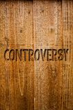 Text sign showing Controversy. Conceptual photo Disagreement or Argument about something important to people Ideas messages wooden. Background intentions Royalty Free Stock Photo