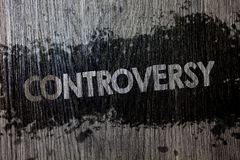 Text sign showing Controversy. Conceptual photo Disagreement or Argument about something important to people Wooden wood backgroun. D black splatter paint ideas Royalty Free Stock Image