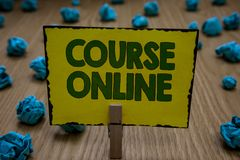 Text sign showing Course Online. Conceptual photo eLearning Electronic Education Distant Study Digital Class Clothespin holding ye. Llow paper note crumpled stock photography