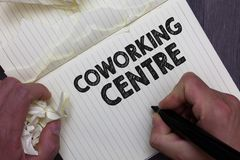 Text sign showing Coworking Centre. Conceptual photo shared workplace often office and independent activity Man holding stock photography