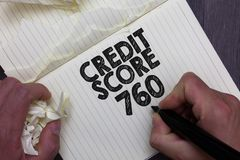 Text sign showing Credit Score 760. Conceptual photo numerical expression based on level analysis of person Man holding marker not. Ebook crumpled papers ripped stock photo