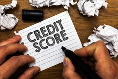Text sign showing Credit Score. Conceptual photo Represent the creditworthiness of an individual Lenders rating Man holding marker. Notebook page crumpled stock photo