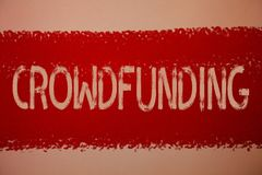 Text sign showing Crowdfunding. Conceptual photo Funding a project by raising money from large number of people Ideas messages red. Paint painting light brown royalty free stock images