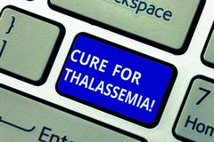 Text sign showing Cure For Thalassemia. Conceptual photo Treatment needed for this inherited blood disorder Keyboard key. Intention to create computer message stock image