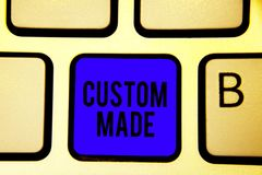 Text sign showing Custom Made. Conceptual photo something is done to order for particular customer organization Keyboard blue key. Intention create computer stock image