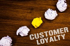 Text sign showing Customer Loyalty. Conceptual photo Client Satisfaction Long-Term relation Confidence Ideas concepts words on woo. Den background crumpled stock images