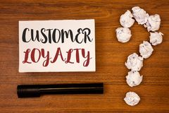 Text sign showing Customer Loyalty. Conceptual photo Client Satisfaction Long-Term relation Confidence Ideas on paper wooden backg. Round quotation mark crumpled royalty free stock image