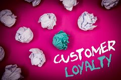 Text sign showing Customer Loyalty. Conceptual photo Client Satisfaction Long-Term relation Confidence Ideas white blue letters pi. Nk background crumpled papers stock image