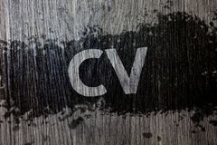 Text sign showing Cv. Conceptual photo Curriculum Vitae Resume Infographics Job Searching Employee Recruitment Wooden wood backgro. Und black splatter paint Stock Images