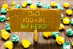 Text sign showing Dad You Are My Hero. Conceptual photo Admiration for your father love feelings compliment Paperclip grip cardboa. Rd with texts many colorful stock image