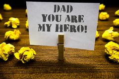 Text sign showing Dad You Are My Hero. Conceptual photo Admiration for your father love feelings compliment Paperclip grip white p. Age with grey text woody royalty free stock photo