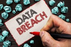 Text sign showing Data Breach. Conceptual photo Stolen Cybercrime Information Hacking Security Malicious Crack written by Man Hold. Ing Marker Cardboard Piece Stock Image