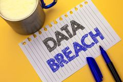 Text sign showing Data Breach. Conceptual photo Stolen Cybercrime Information Hacking Security Malicious Crack written on Notebook. Text sign showing Data Breach Stock Photography