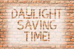 Text sign showing Daylight Saving Time. Conceptual photo advancing clocks during summer to save electricity Brick Wall. Text sign showing Daylight Saving Time stock images