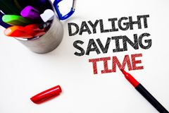 Text sign showing Daylight Sayving Time. Conceptual photo advancing clocks during summer to save electricity Pen white background. Grey shadow important temple Royalty Free Stock Image