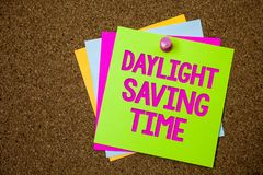 Text sign showing Daylight Sayving Time. Conceptual photo advancing clocks during summer to save electricity Postcards various col. Our brown background lovely Stock Photos