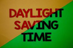 Text sign showing Daylight Sayving Time. Conceptual photo advancing clocks during summer to save electricity Yellow green split ba. Ckground message thoughts Stock Photography