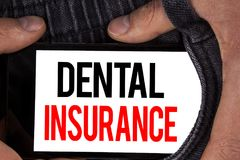 Text sign showing Dental Insurance. Conceptual photo Dentist healthcare provision coverage plans claims benefit written on Mobile. Text sign showing Dental Stock Photography