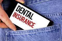Text sign showing Dental Insurance. Conceptual photo Dentist healthcare provision coverage plans claims benefit written on Mobile. Text sign showing Dental Royalty Free Stock Photo