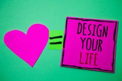 Text sign showing Design Your Life. Conceptual photo Set plans Life goals Dreams take control To do list Hart memories love pink g. Reen background love lovely royalty free stock photos
