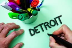 Text sign showing Detroit. Conceptual photo City in the United States of America Capital of Michigan Motown Man holding black mark. Er white background markers stock photos