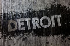 Text sign showing Detroit. Conceptual photo City in the United States of America Capital of Michigan Motown Wooden wood background. Black splatter paint ideas Stock Images