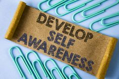 Text sign showing Develop Self Awareness. Conceptual photo improve your Informations about surrounding events written on Folded Ca. Text sign showing Develop stock photography