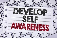 Text sign showing Develop Self Awareness. Conceptual photo What you think you become motivate and grow written on Notebook paper p. Text sign showing Develop royalty free stock photo