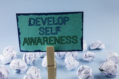 Text sign showing Develop Self Awareness. Conceptual photo What you think you become motivate and grow written on Sticky Note Pape. Text sign showing Develop stock image