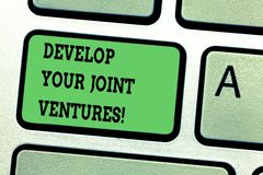 Text sign showing Develop Your Joint Ventures. Conceptual photo Business partnership cooperation growing Keyboard key. Intention to create computer message stock image
