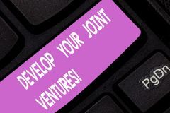 Text sign showing Develop Your Joint Ventures. Conceptual photo Business partnership cooperation growing Keyboard key. Intention to create computer message stock photography