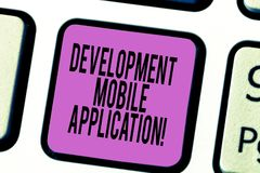 Text sign showing Development Mobile Application. Conceptual photo Writing software for digital devices Keyboard key. Intention to create computer message stock photos