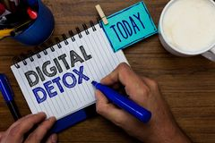 Text sign showing Digital Detox. Conceptual photo Free of Electronic Devices Disconnect to Reconnect Unplugged Man. Holding marker notebook clothespin reminder royalty free stock image
