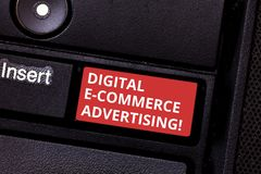 Text sign showing Digital E Commerce Advertising. Conceptual photo Trading of goods and services using the web Keyboard. Key Intention to create computer stock images