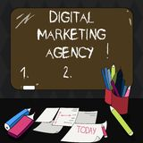 Text sign showing Digital Marketing Agency. Conceptual photo Helps business engage with exact target audiences Mounted Blank Color. Blackboard with Chalk and royalty free illustration