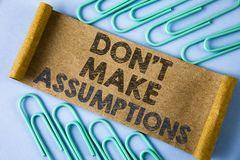 Text sign showing Do not Make Assumptions. Conceptual photo predict events future without clue Alternative Facts written on Folded. Text sign showing Do not Make stock photos