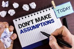 Text sign showing Do not Make Assumptions. Conceptual photo predict events future without clue Alternative Facts written by Man on. Text sign showing Do not Make royalty free stock images