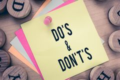 Text sign showing Do s is and Don t not s is. Conceptual photo Confusion in one's mind about something.  royalty free stock image