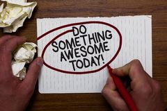 Text sign showing Do Something Awesome Today. Conceptual photo Make an incredible action motivate yourself Hand hold paper lob and. Red pen red circled black royalty free stock images