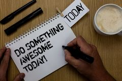 Text sign showing Do Something Awesome Today. Conceptual photo Make an incredible action motivate yourself Paperclip retain writte. N notepad hand hold marker Stock Photo